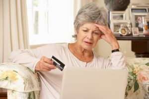 picture of a Frustrated Senior Woman Sitting At Home Using Laptop