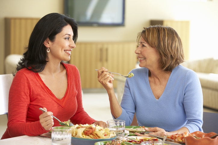 image of daughter eating with mother